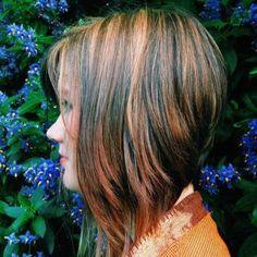 angled bob haircut with red highlights
