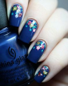 Navy blue nails with floral pattern. Cute nails.