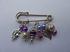 Purple bead and silver tone charm kilt pin brooch