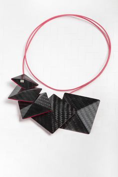Vanda Ferencz necklace made of carbon fiber.