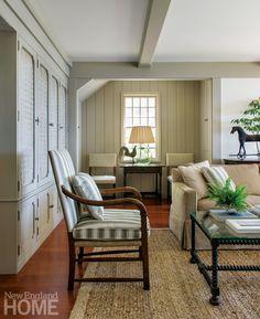 charming cape cod living room with weathervane and pulltoy horse...