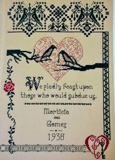 A Gomez & Morticia cross-stitch piece