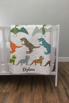 Fun Dino Quilt - you can personalize this with your own child's name and you can change the colors. Design in 5 to 10 minutes and its shipped in 5 to 7 days
