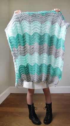 Feather and Fan Baby Blanket | Keep your baby snuggled up in style with this easy crochet baby blanket.