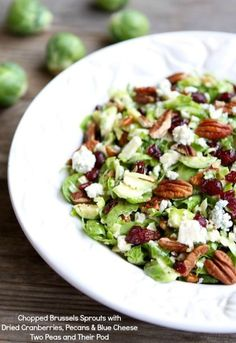 Chopped Brussels Sprout Salad with Dried Cranberries, Pecans, and Blue Cheese | Recipe on twpoeasandtheirpod.com
