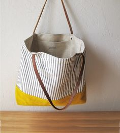 Two tone tote in golden yellow and indigo stripe.