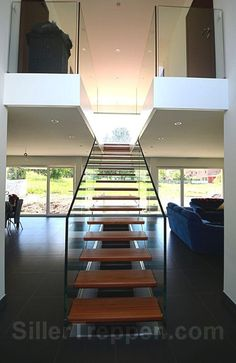 floating stairs, free standing stairs, two sides structural glass railings. seamless glass railings http://www.sillertreppen.com/en/siller-stairs/
