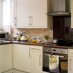 Neat neutral kitchen - versatile style.  Interesting placement of small microwave in deep window recess.