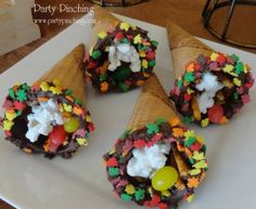 cone dipped in chocolate, rolled in fall colored sprinkle leaves and filled with goodies for the kids on Thanksgiving.