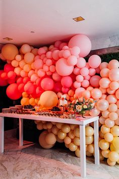 This couple made sure guests knew where the sweets were with a floor-to-ceiling balloon installation positioned behind the dessert table. The vibrant sherbet-y shades of bright pink, orange, and yellow were the perfect choice for their modern Palm Springs celebration.