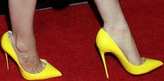 Jessica Chastain wearing yellow Christian Louboutin pumps at CinemaCon 2017