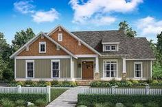 This charming craftsman cottage house plan features 3 bedrooms and open-concept living. Browse our house plans today!