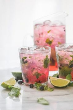Minty and fruity, light and easy, this larger batch blueberry mojito recipe is the perfect cocktail for spring and summer entertaining!