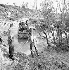 "A Sherman tank of ""A"" Squadron, Ontario Regiment, crossing a stream near Colle d'Anchise, Italy, 26 October 1943. a204149-v6"