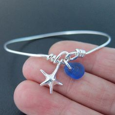 Sea Glass Jewelry - Sea Glass Bracelet Your choice of sea glass from the picture and charm from the picture will be made into a custom sea glass bangle bracelet. The sea glass is from Costa Ri Sea Glass Jewelry, Wire Jewelry, Jewelry Crafts, Handmade Jewelry, Yoga Jewelry, Gold Jewellery, Handmade Bracelets, Pendant Jewelry, Earrings Handmade