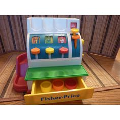 Awh, remember this? Vintage Fisher Price Cash Register 1990 by WishfulSpirit on Etsy, $25.00