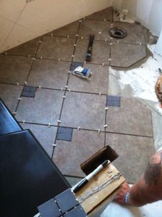 Laying tile (over new subfloor, of course)!