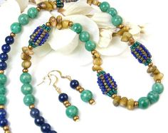 This lovely tribal necklace and earrings set features handmade beads from Africa, green Russian amazonite, lapis lazuli, and brown bamboo coral. The