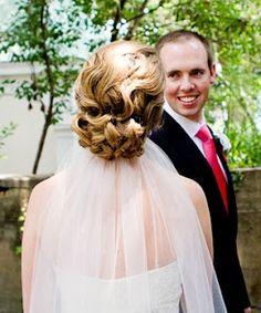 small wedding veil tucked into bun