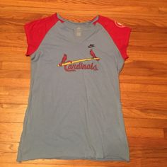 STL Cardinals Cooperstown Tee Cute with shorter sleeves and a torn looking v-neck. Cooperstown by Nike. Tee is 100% cotton. Never worn! Bought at Busch Stadium! ❌no trades❌ Nike Tops Tees - Short Sleeve