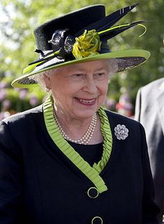 She almost always is wearing the 3 strand pearls given to her by her grandfather the King.