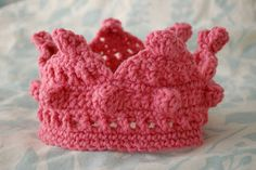 Crown for a king or queen!  Before you start, thread about 75 beads on the yarn, and when you get to a place you want a bead, just push it up to the hook and add it in.