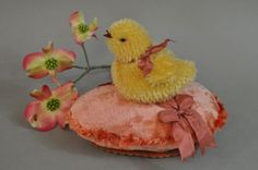 A Mohair peeper atop a vintage velvet egg pin keep  embellished with vintage chenille and ribbon. by Lori Ann Corelis