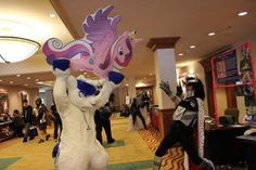 Shining Armor vs. King Sombra. I normally abhor fursuits but this is pretty funny.