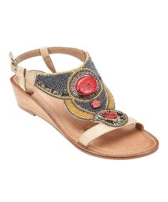 beaded coral sandals on vacheta leather and a modest wedge heel. Low price version of the Dries Van Noten workmanship.