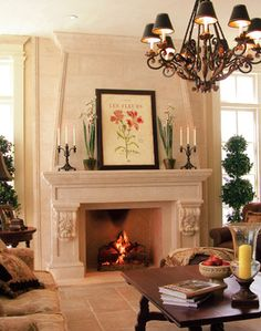 Traditional living room with cast stone fireplace adds intricate detail and substance  |  Andrea's Innovative Interiors - Andrea's Blog - Warm up by the Fire
