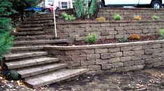 Steep Hillside Landscaping | Boulder Wall With Steps