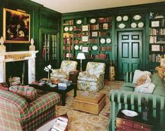 Cozy, rich library with green walls, velvet couch, chairs in a floral chintz and plaid - Groton Place - Westbury, NY - Windham House
