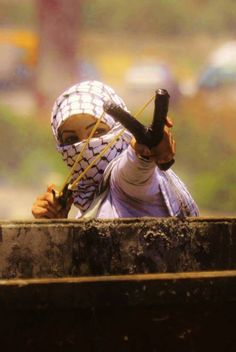 What a brave fighter. I love the picture. I wish her victory against her Apartheid rulers. I always take the side of the stone throw, not the tank operator.