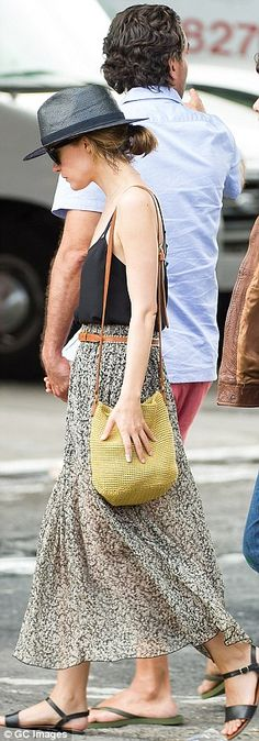 Low-key look: Rose Byrne accessorised her outfit with a black fedora, sunglasses, bucket bag and sandals