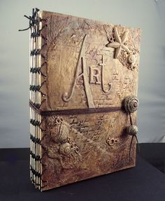 Very creative approach to a sketchbook--you'd want to open it and fill it with inspiration! Art Journal by Samantha_Braund, via Flickr