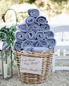 Let guests keep cozy during an outdoor ceremony with warm blankets! You can also do the same for thongs, umbrellas and anything else your guests might require!