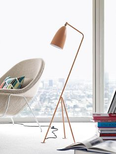 This gubi Grasshopper floor lamp is designed by Greta Grossman with salmon brass finish and powder coated steel frame will add modern mid century look for your apartment living