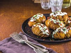 This potato recipe produces the perfect example of stuffed hasselback potatoes. Golden, buttery potatoes are topped with crispy bacon and plenty of cheese - this dish is true comfort food!