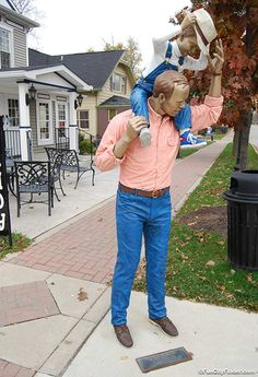 Picture of a father and son sculpture by J. Seward Johnson in Carmel, Indiana