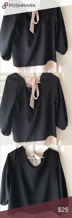 Black and cream open back tie shirt Beautiful black and cream open / low back tie shirt /blouse. Cream section on bottom as well as tie. Worn once. Bought from the boutique Fab'rik. In great condition. fab'rik Tops Blouses