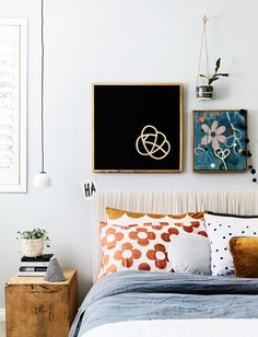 """I like my bedroom to be as simple and quiet as possible. I read novels when I can and they're littered everywhere,"" Rachel says. She made the bedhead by stretching a silk fabric over a canvas."
