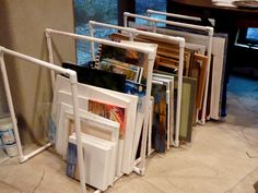 PVC canvas and painting storage: built by hubby with my inspiration. Filled Artist Storage, Art Studio Storage, Art Supplies Storage, Art Studio Organization, Storage Organization, Organizing, Basement Storage, Built In Storage, Pvc Storage