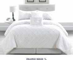6 Piece Queen Melia White Comforter Set...comforter, 2 shams, bedskirt, 2 decorative pillows; $79.99...just says machine washable, does not say what the fabric is.