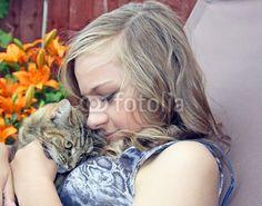 young girl hugging her pet cat © lizascotty