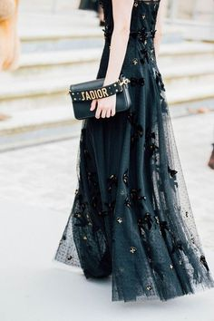 Carrie approves! How chic is this black dress with tule layering?