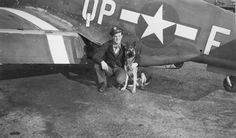 "Ralph ""Kidd"" Hofer with his dog ""Duke"" in front of a P-51, 1944.  Both of Hofer's P-51s were coded QP-L so this kite must belong to a squadron mate of his."