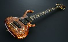 """""""Flora Aurum"""" custom 5-string electric bass guitar by Jens Ritter (Germany) sold by Wynn & Co. for $250,000(!). Gold leaf inlays!"""