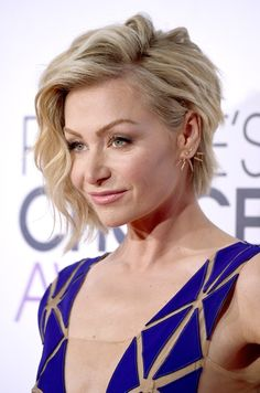 Portia de Rossi's Side-Swept Waves and Blushing Glow