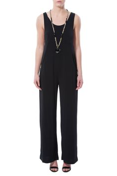 Sleeveless flare leg jumpsuit with pockets and oversized arm holes. Pair this with a neon bandeau for a fun outfit. Wear with heels for a sexy look!   Chic Jumpsuit by BCBGeneration. Clothing - Jumpsuits & Rompers - Jumpsuits Georgia