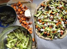 Nettle Pesto Pizza: whole wheat honey crust topped with nettle pesto, roasted sweet potatoes, slivered asparagus and goat cheese